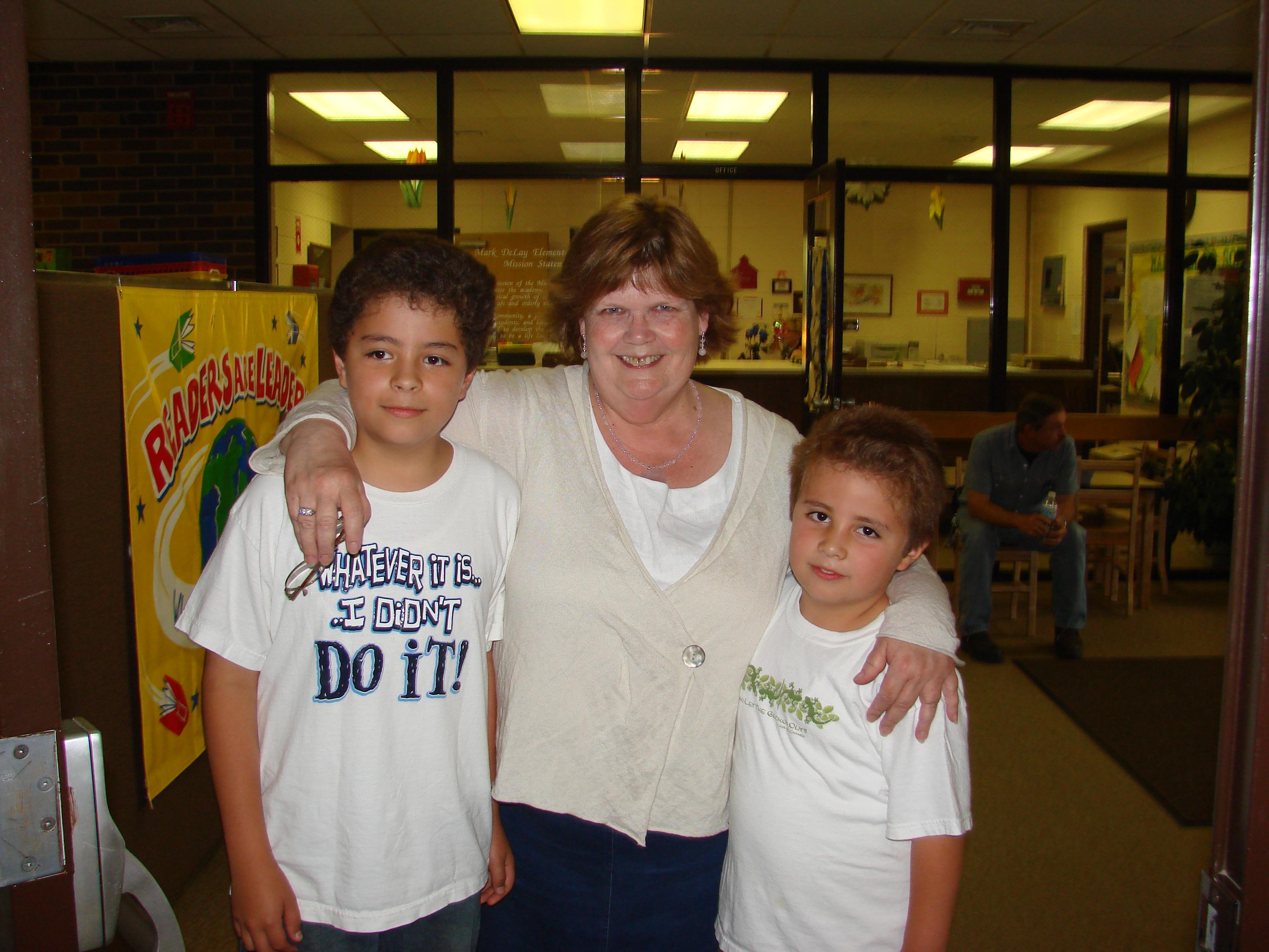 The Moreno brothers with Mark DeLay Principal Miss Kelly.